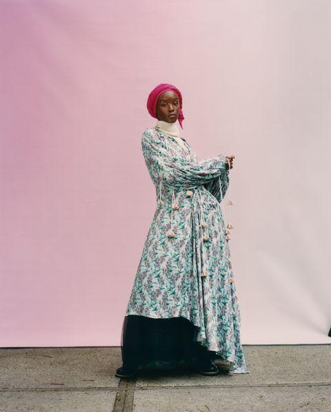 model in floral dress and pink hijab